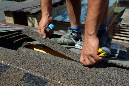 Repair of a Roofing from shingles. Roofing cutting roofing. Roof Shingles - Roofing. Bitumen tile roof.