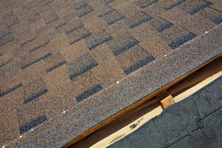 nails: Installing Bitumen Roof Shingles. Roof Shingles - Roofing. Stock Photo