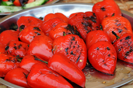 Red peppers on a grill. roasted red peppers. Stock Photo