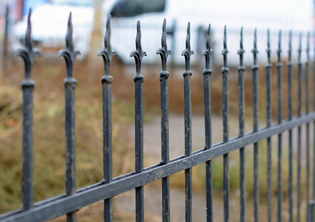 Old wrought fence. Image of a decorative cast iron fence. Metal Forged Fence.Old fence with forging
