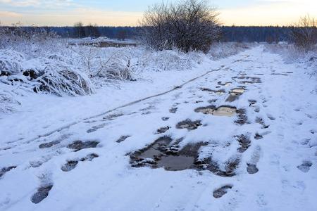 Bad muddy winter road. Beautiful winter landscape