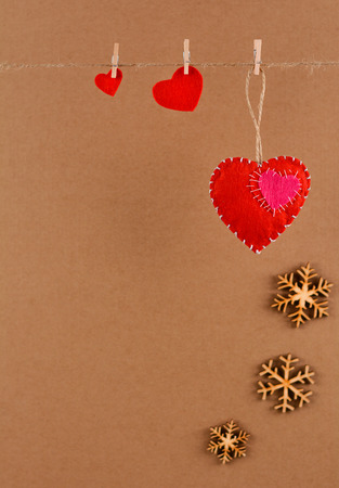 Happy Valentines day. Valentine background with felt hearts on clothespins Stock Photo
