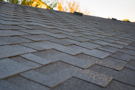 Close up view on asphalt roofing shingles Stock fotó