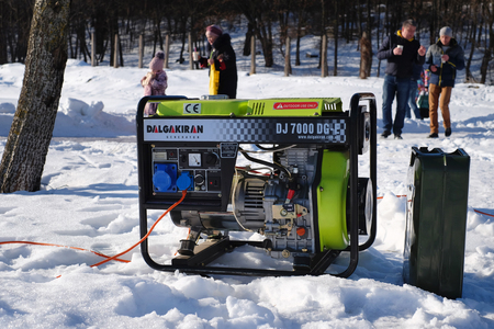 Irpin, Ukraine - January 19, 2019: Portable electric generator running in the cold winter.