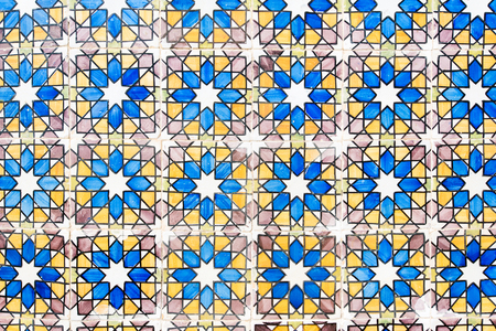 Old wall with traditional Portuguese decor tiles azulezhu in blue,yellow and brown tones. Imagens