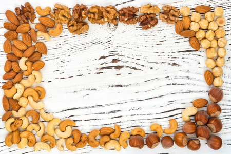 Various nuts as concept healthy snack. Food background frame.