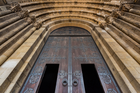 Beautiful Lisbon cathedral doorway closeup. Forged patterns.