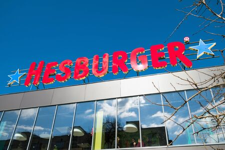 Irpin, Ukraine - March 9, 2019: Logo of Finnish fast food company Hesburger on the roof.