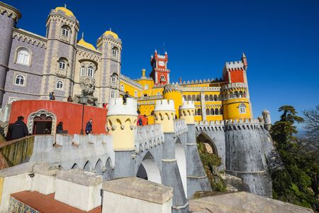 SINTRA, PORTUGAL - FEBRUARY 11, 2019: Tourists walks and take pictures in the Pena palace of sintra.