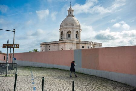 LISBON, PORTUGAL - FEBRUARY 10, 2019: Young woman looks into the map in front of The National Pantheon or Church of Santa Engracia.