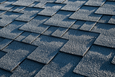 Close up view on asphalt roofing shingles covered with frost Stok Fotoğraf