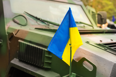 Military armored vehicle with the flag of Ukraine.