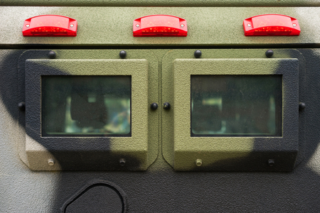 Closeup window and signal lights on military armored vehicle made with solid steel. Stockfoto