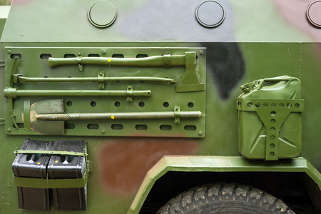Closeup military armored vehicle with attached tool.