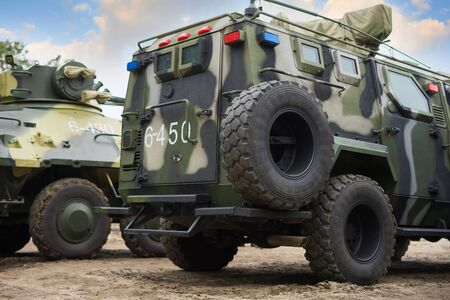 UKRAINE - MAY 9, 2019: Military armored personnel carrier and vehicle are on display  against the sky. Editorial