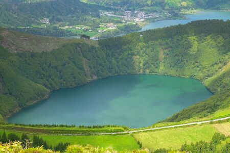 Beautiful view of the road to background volcanic lakes (Lagoa de Santiago). Azores, Sao Miguel, Portugal