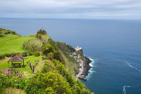 Beautiful view of the lighthouse and the ocean from a cliff in the city of Nordeste, Azores, Portugal Stok Fotoğraf