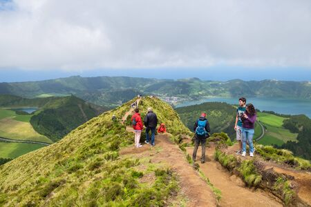 San Miguel, Portugal - May 12, 2019: Tourists enjoy of beautiful view from Boca do Inferno at island Azores.