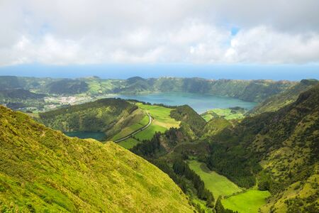 Beautiful view of the road to background volcanic lakes and forest. Azores, Sao Miguel, Portugal