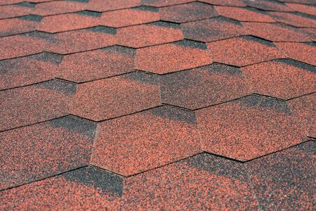 Close up view on asphalt roofing shingles.