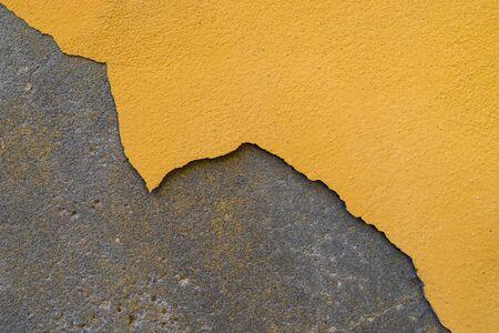 Paint peeling off the plastered wall. The building needs repair. Stock fotó