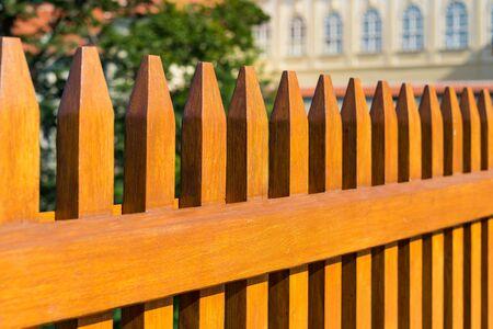 Beautiful wooden fence around garden in summer time. Stock fotó