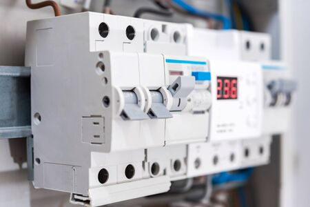 Closeup view automatic fuses and voltage relay. Electrical background. Stock fotó