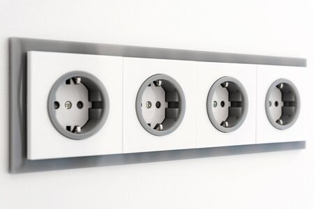 Installation modern sockets on a painted wall close-up. Grey and white electrical outlet.