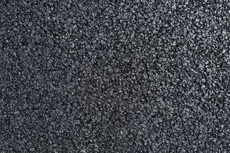 A new dark grey asphalt pavement texture.