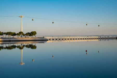 LISBON, PORTUGAL - FEBRUARY 12, 2019: Telecabine Lisboa at Parque das Nacoes. The cable car against the Tagus river.