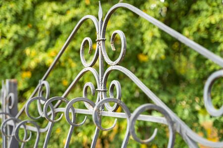 Image of a Beautiful decorative cast iron wrought fence with artistic forging. Metal guardrail close up. Stock fotó