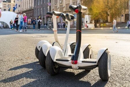 Three electric scooter are staying in the park for rent. Stock fotó