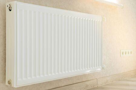 Individual heating radiator on a wall at an apartment.