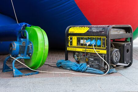 Irpin, Ukraine - September 21, 2019: A gasoline generator for generating electrical energy is used for inflatable attractions. Emergency or Auxiliary Electric Power during various events. Editorial