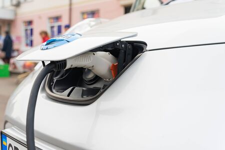 Nizhyn, Ukraine - October 12, 2019: Close up of the power supply plugged into an electric car being charged.