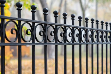 Image of a Beautiful decorative cast iron wrought fence with artistic forging. Metal guardrail close up. Stock Photo