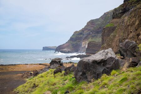 Rocks and stones near a stormy sea or ocean. Beautiful landscape.
