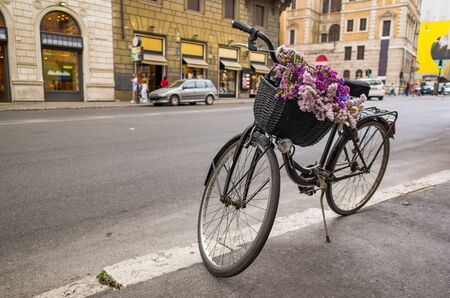 Bicycle with flowers on an street in Rome.