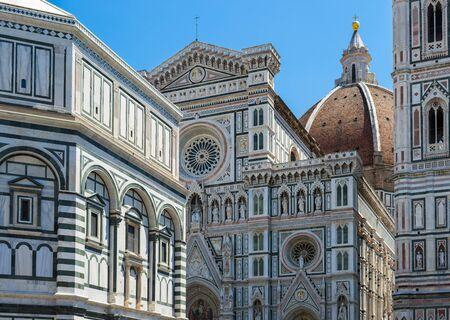 Firenze, Italia - 23 June 2019: Towers and beautiful statues of Cattedrale di Santa Maria del Fiore e Campanile di Giotto.