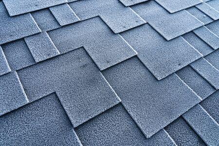 Asphalt roof bitumen shingles covered with frost. Banco de Imagens