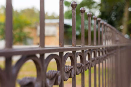 Image of a Beautiful decorative cast iron wrought fence with artistic forging. Metal guardrail close up. 版權商用圖片