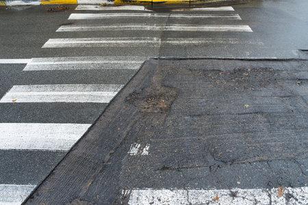 Partial repair crosswalk. Preparation for cladding of bad roads.