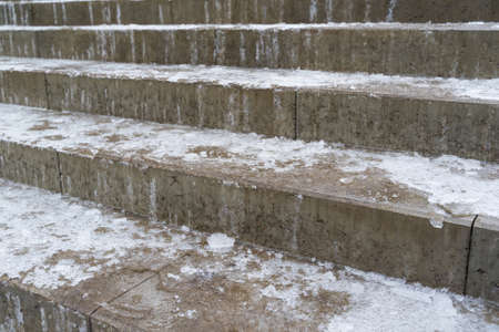 Ice on the stair steps is a hazard to pedestrian traffic. 스톡 콘텐츠