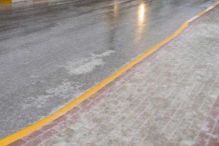 Ice on the road. Dangerous weather for the movement of pedestrians and cars. 스톡 콘텐츠