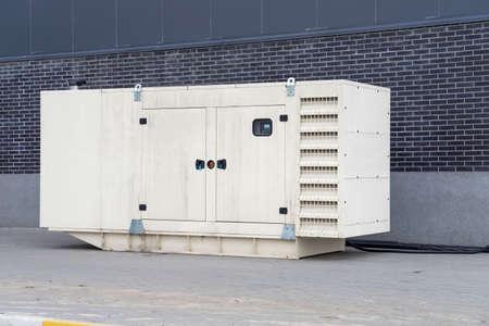 Diesel generator for emergency electric power near the building. Banco de Imagens