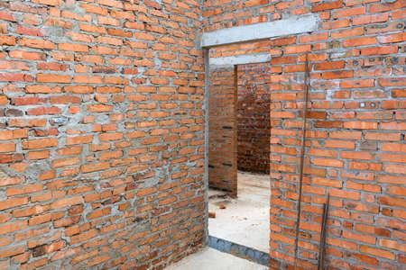 Door monolithic concrete lintel unfinished building construction.