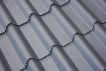 Metal roof construction. Background of building materials close-up. Banco de Imagens