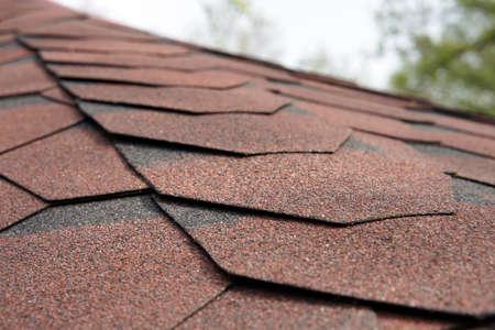 Close up view on asphalt roofing shingles background. Banco de Imagens