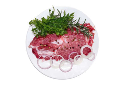 Raw steak with fresh onions and spices