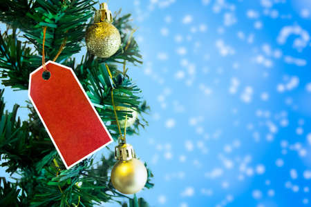 Christmas tree with red empty label, concept- Christmas discounts Stock Photo